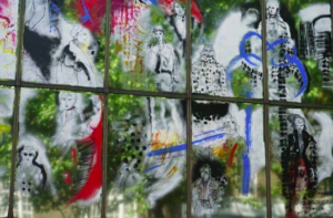 Live illustrated mural of fashion figures on large scale windows