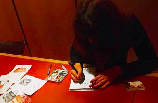 woman drawing live portraits at Moynat Mayfair